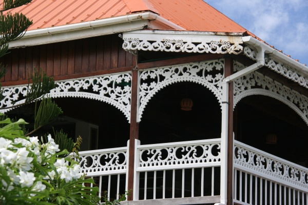 The Frangipani Hotel with its beautiful Gingerbread style of architecture.